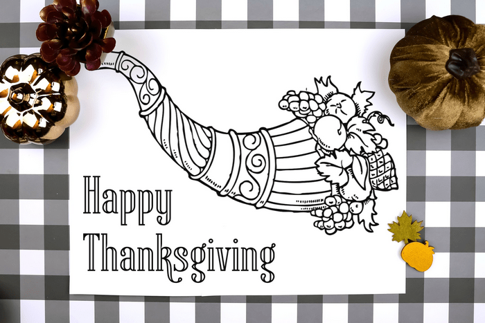 thanksgiving coloring page placemat on a plaid background