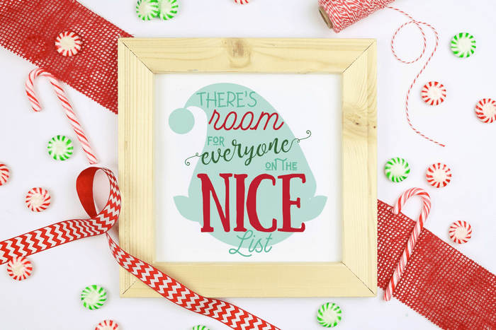 elf quote printable in a wood frame with ribbons and candies