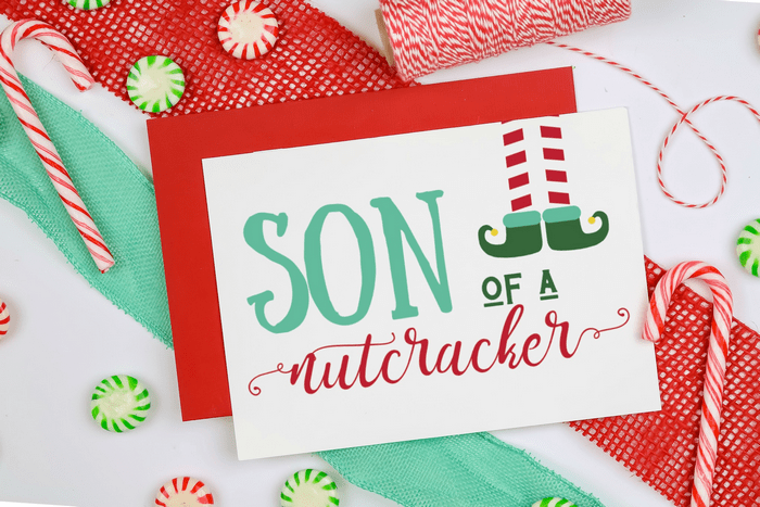 elf quote printable design on a Christmas card with ribbon, twine and candy