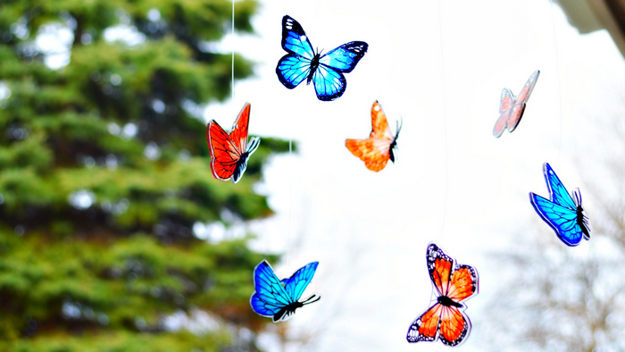 blue and orange shrink plastic butterfly mobile outside