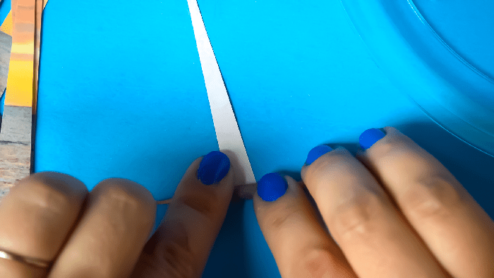 woman\'s hands rolling paper around a toothpick
