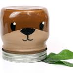 otter painted mason jar on a white background