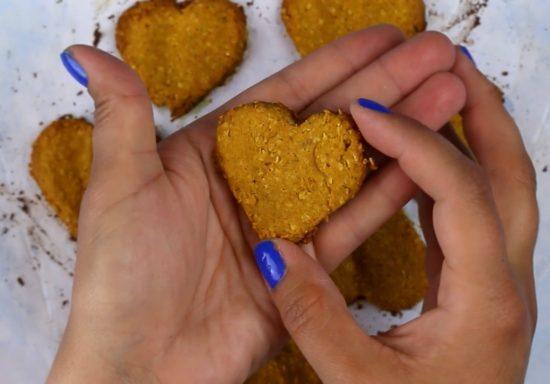 hands holding homemade pumpkin dog treats