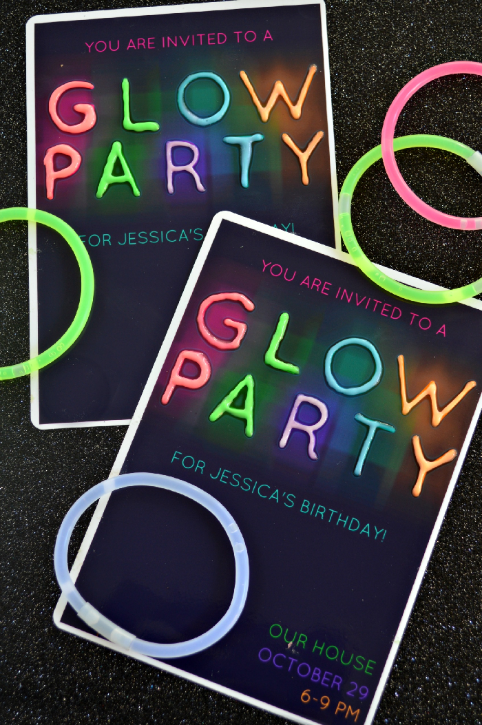 Glow party invitations and glow bracelets on a black background
