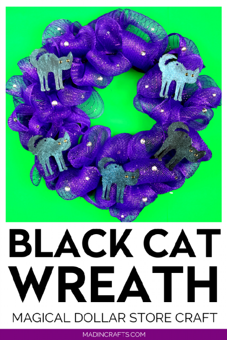 purple mesh wreath with black cat shapes and rhinestones on a green background
