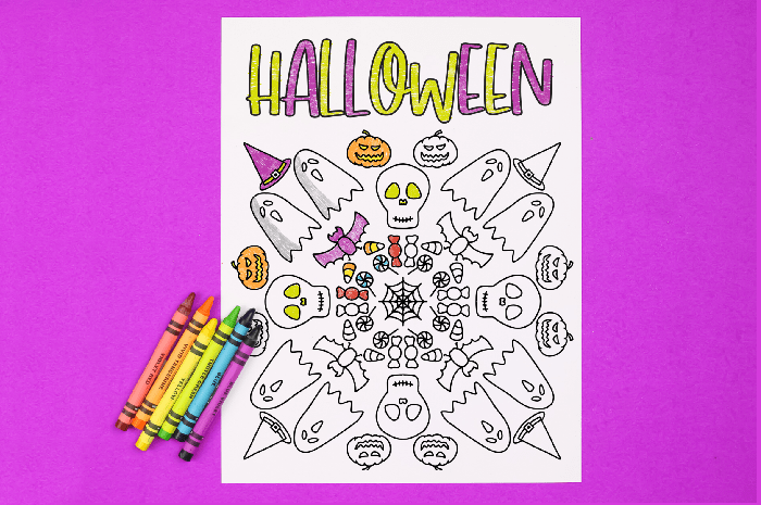 Halloween coloring page with crayons on a purple background