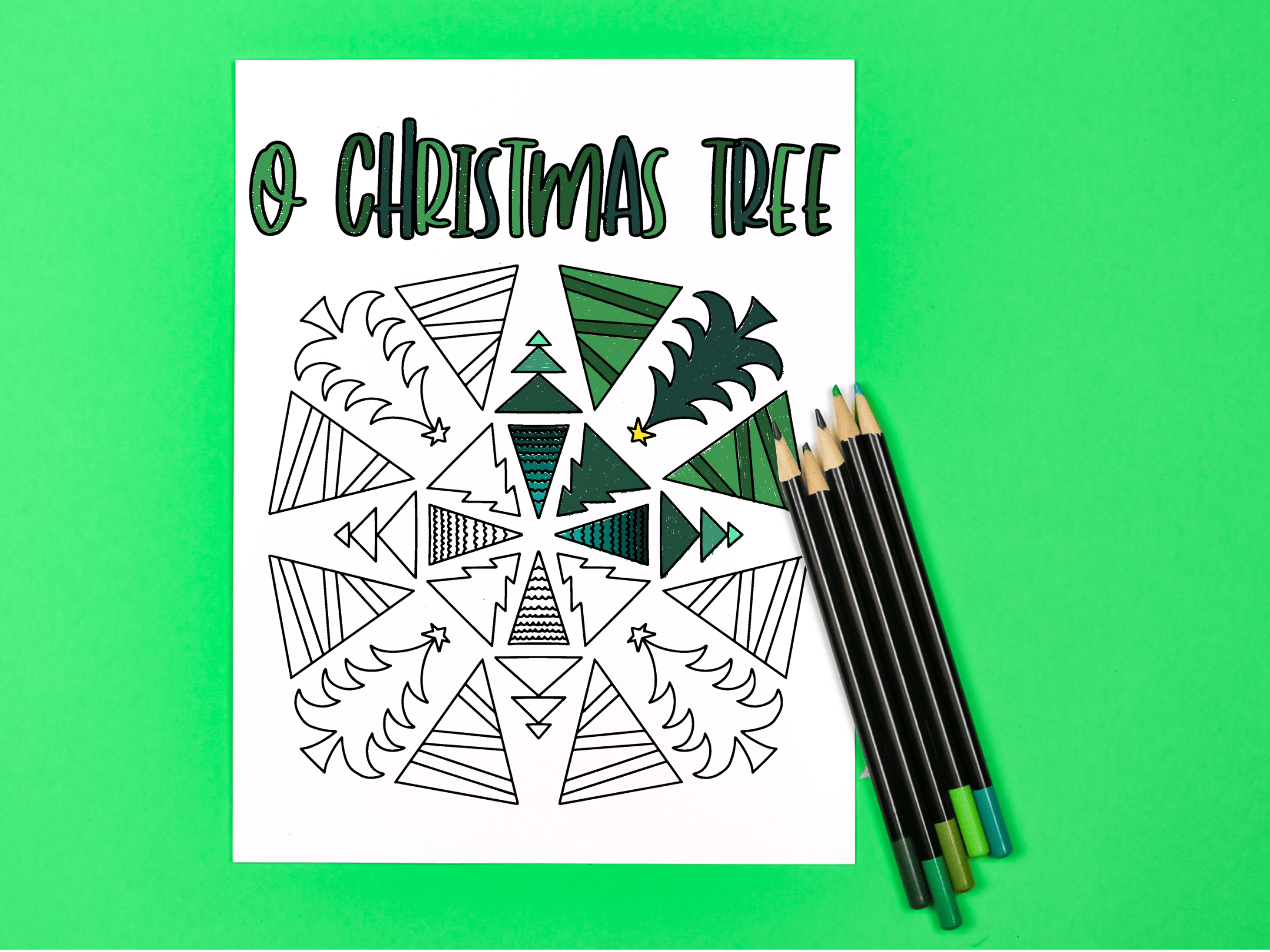 O Christmas Tree coloring page with colored pencils on a green background