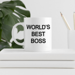 World's Best Boss Mug on a stack of books near a plant