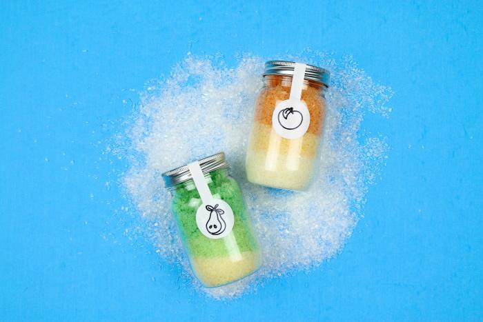 jars of epsom salts on a blue background