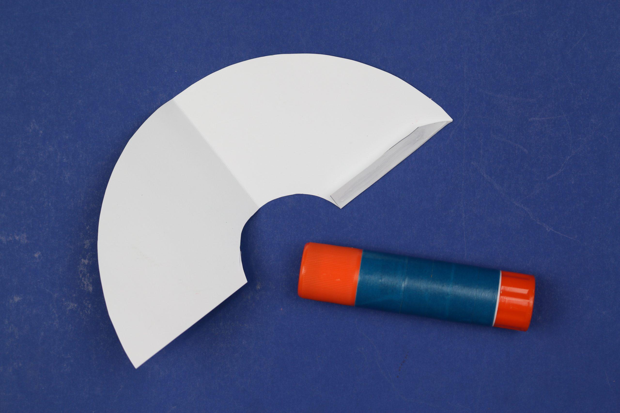 folded rainbow bookmarks and a glue stick