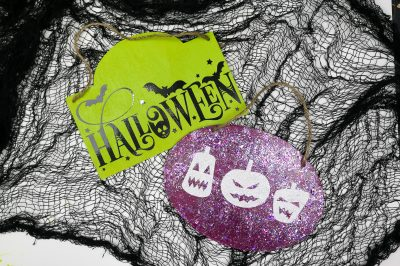 two Halloween signs made with dollar store vinyl