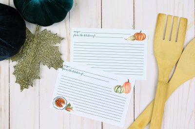 Printable Thanksgiving recipe cards next to blue pumpkins and wood serving utensils