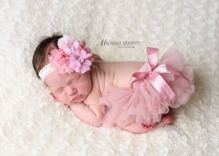 Baby girl newborn photography   Phoenixville PA   Magnolia Moments         Newborn baby girl dressed in pink newborn baby clothes for her newborn  photoshoot by photographers near