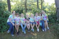 Girl Scouts take a break during their camping trip.