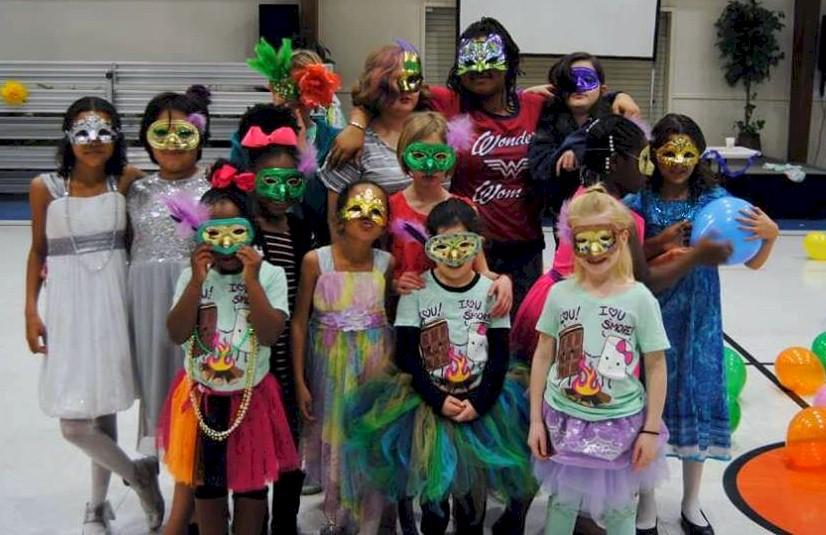 Girl Scouts at a masquerade ball.