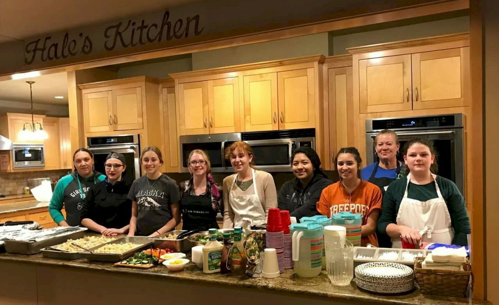 Girl Scout preparing dinner at the Ronald McDonald house.