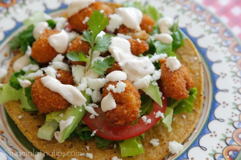 popcorn shrimp tostada with chipotle cream and avocado