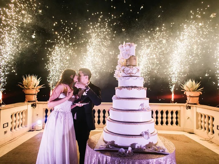 Everything You Need to Know About Cutting the Cake at Your Reception Wedding reception cake cutting ceremony and fireworks display