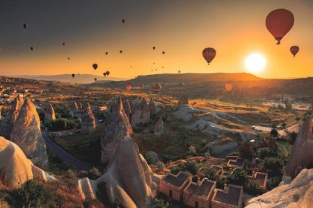 hot air balloons flying over mountains landscape sunset cappadocia hot air balloons flying over mountains landscape sunset cappadocia turkey stock photo