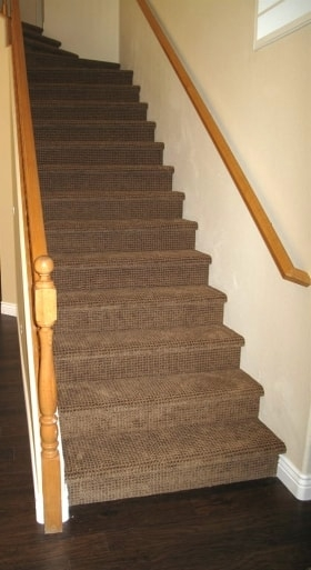 How To Choose Carpet For High Traffic Areas Angie S List | Dark Carpet On Stairs | Gray | Monochrome | Wall | Modern | Metal Bar On Stair