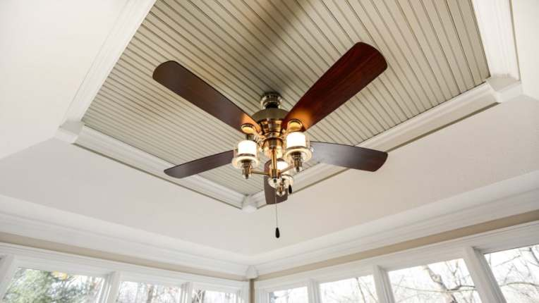 Installing a Ceiling Fan   Angie s List ceiling fan with wood blades and glass globe lights
