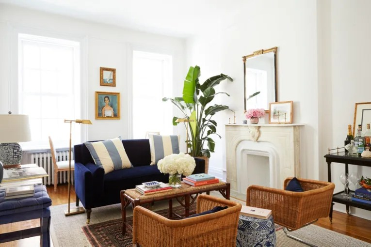 8 Small Living Room Ideas That Will Maximize Your Space     Amy Stone s Brooklyn living room  featuring wicker chairs and a small  velvet sofa