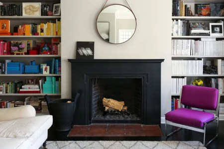 8 Small Living Room Ideas That Will Maximize Your Space     Bookshelves flanking a fireplace in Lauren Goodman s home