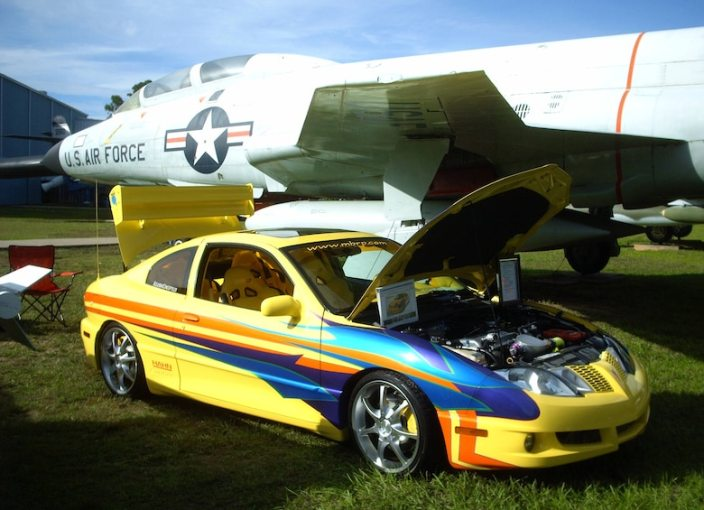 1955 ford cars » Automobiles  past and present  on display at Commando Cruise In     A Pontiac Sunfire with a custom paint job is parked beside an F 101 at