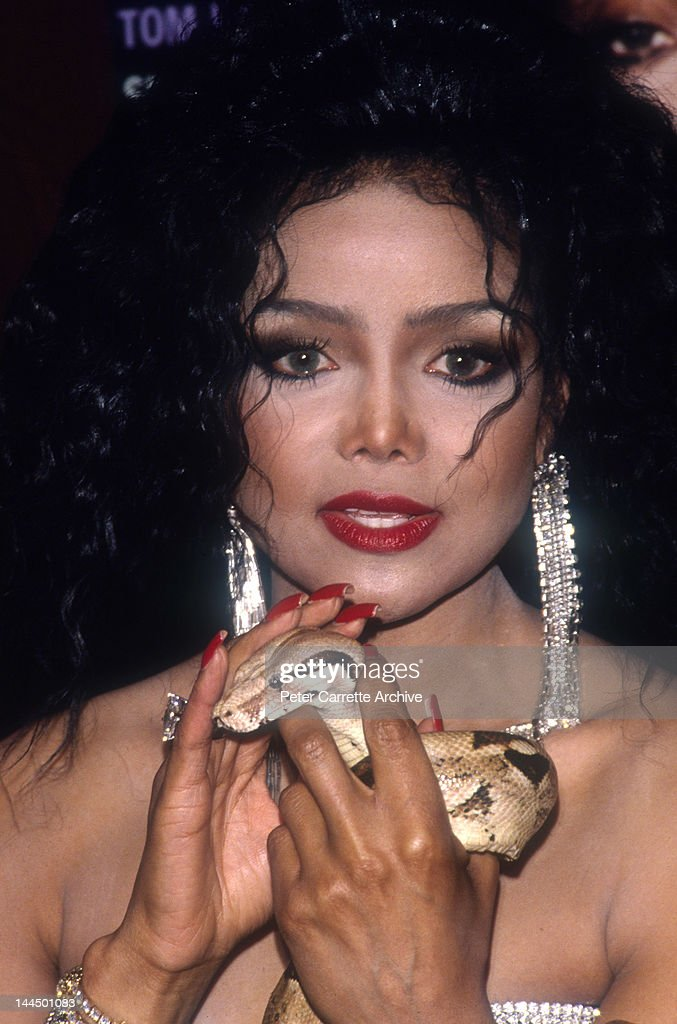 American singer La Toya Jackson poses with a snake during ...