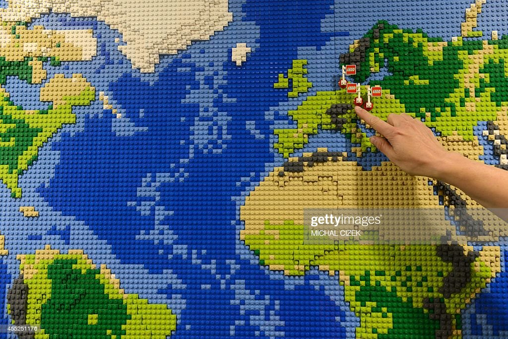 An employee of Danish firm Lego shows the Lego factories in Europe     An employee of Danish firm Lego shows the Lego factories in Europe on the  map made