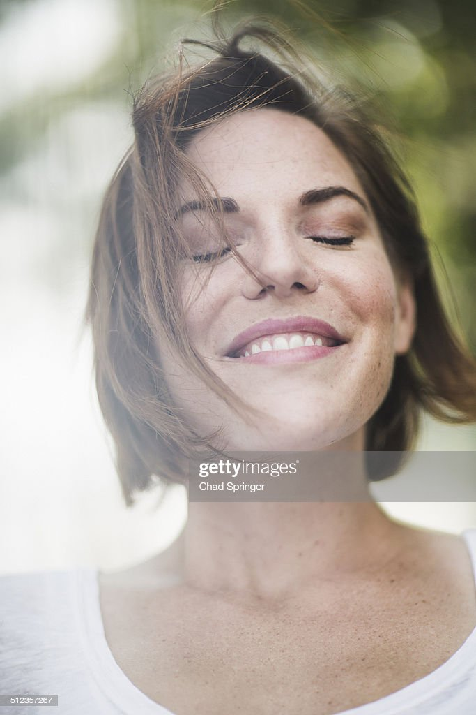 Close Up Portrait Of Smiling Mid Adult Woman With Eyes ...
