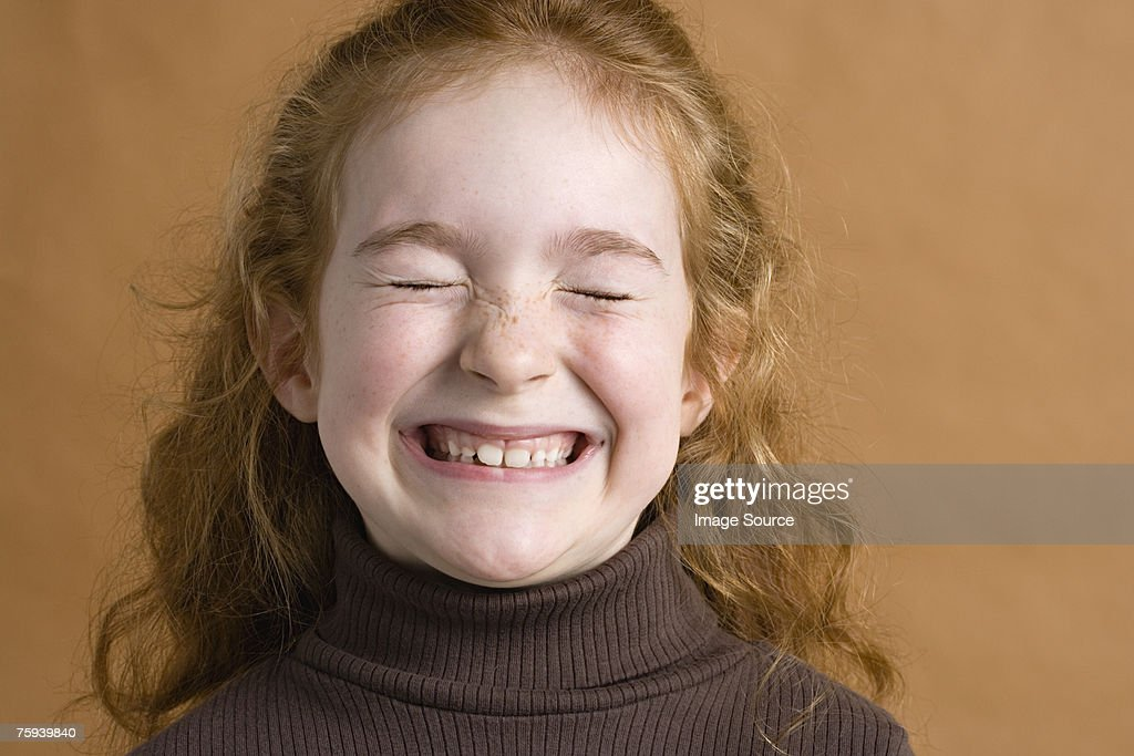 Girl Smiling With Eyes Closed High-Res Stock Photo - Getty ...