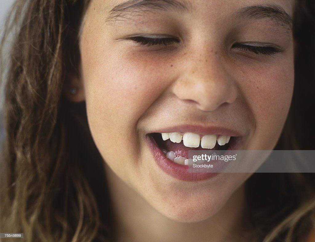 Girl Smilingeyes Closedcloseup Stock Photo - Getty Images