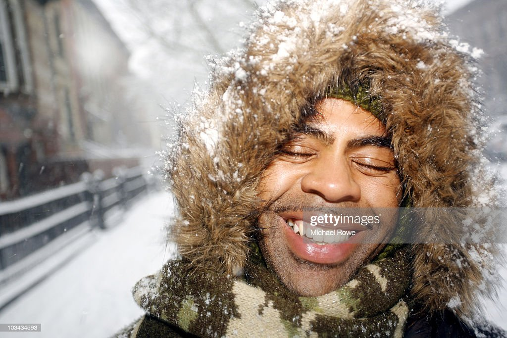 Man Smiling With Eyes Closed Covered With Snow Stock Photo ...