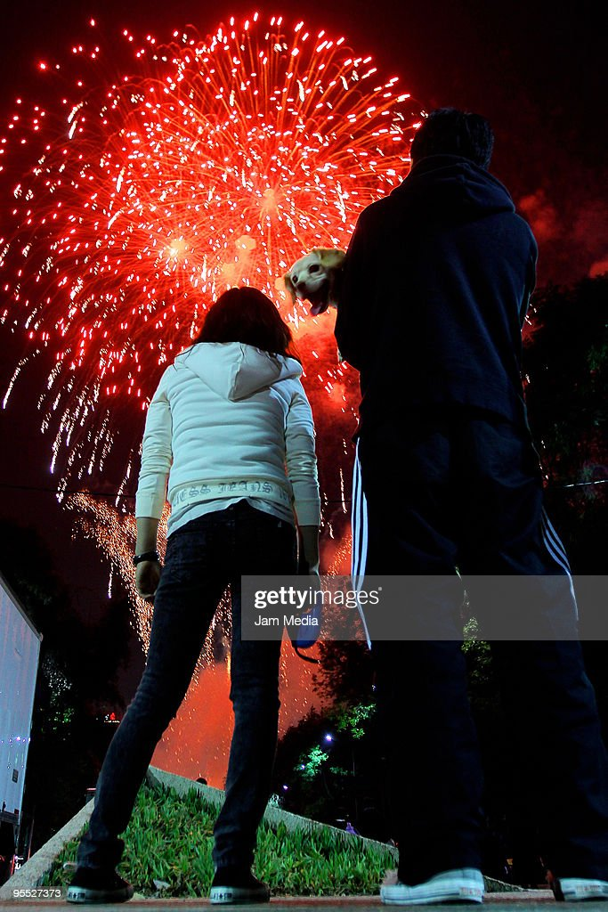 Mexico Celebrates New Year Photos and Images   Getty Images People gather to watch the Fireworks show during the New Year s eve  celebrations in Mexico on
