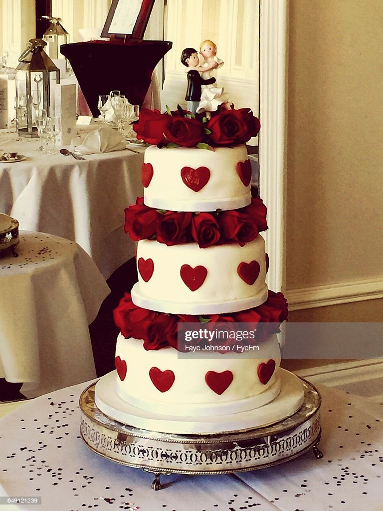 Wedding Cake With Red Roses On Table Stock Photo   Getty Images Wedding Cake With Red Roses On Table   Stock Photo