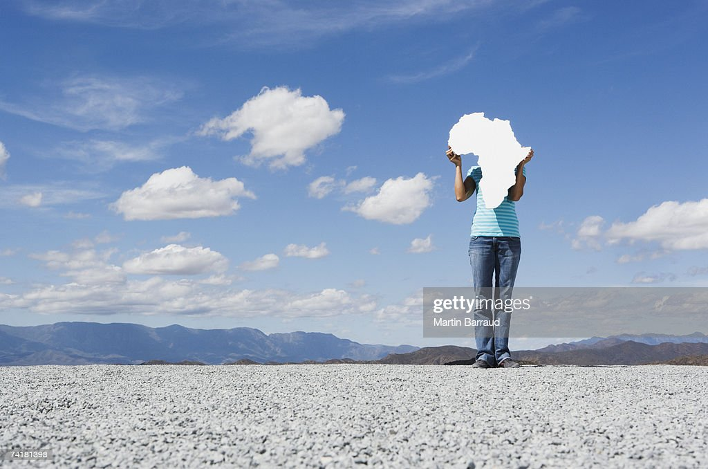 Woman Holding Blank Map Of Africa Stock Photo   Getty Images Woman holding blank map of Africa   Stock Photo
