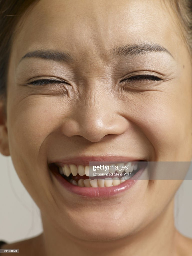 Young Woman Smiling With Eyes Closed High-Res Stock Photo ...