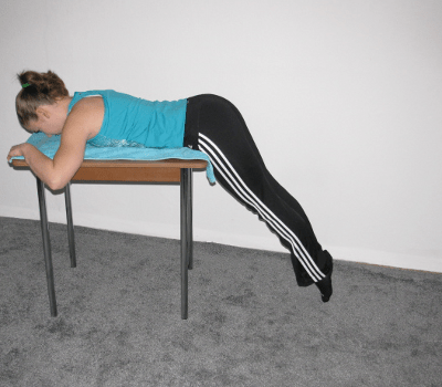 Reverse Hyperextension On Table Form Muscles Worked Benefits