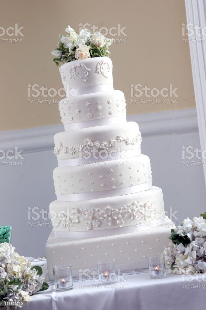 Fancy Elegant Tall Large White Cake At Wedding Reception