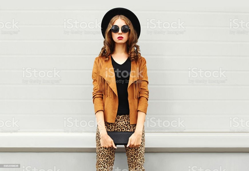 Royalty Free Fashion Pictures  Images and Stock Photos   iStock Fashion woman wearing elegant hat  jacket handbag clutch over background  stock photo