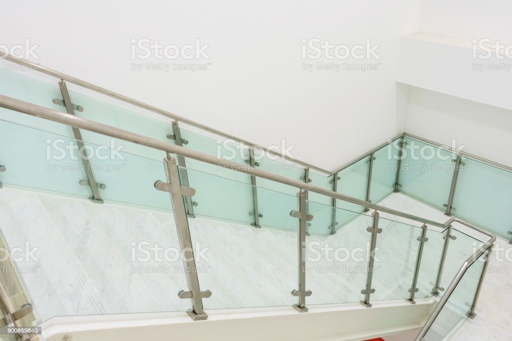 Modern White Marble Stairs With Steel And Glass Railing In A New   White And Glass Staircase   Step   Before And After   Handrail   Stained   Oak