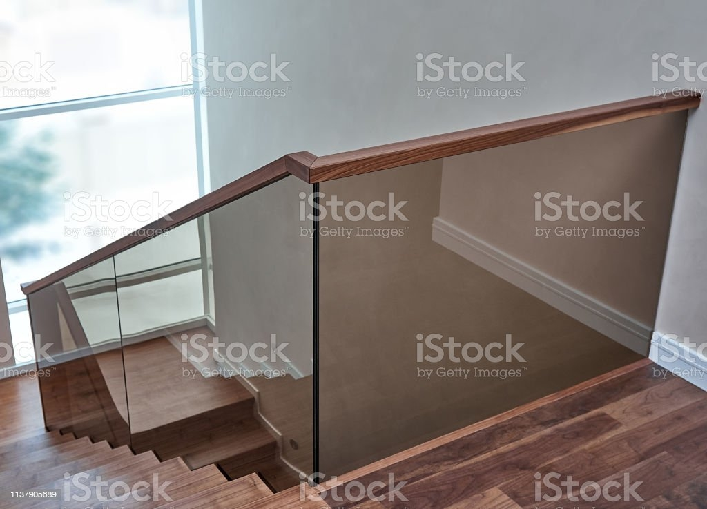 Part Of Wooden Steps With Glass Railings Walnut Staircase Stock | Wood And Glass Staircase | Stair Case | Simple | Spiral | Small | Light Oak Glass
