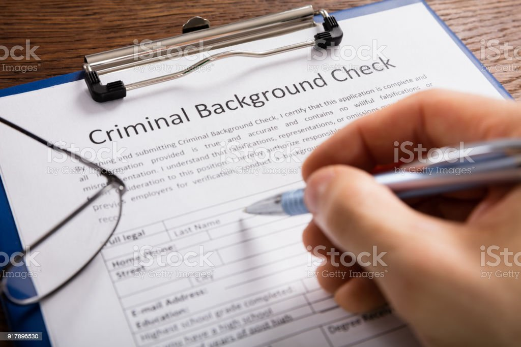 Person Filling Criminal Background Check Application Form Stock     Person Filling Criminal Background Check Application Form royalty free  stock photo