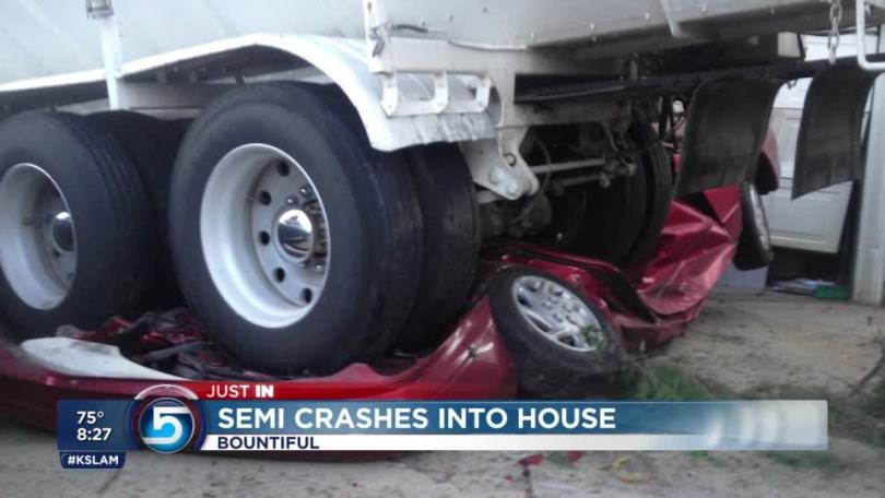 Semitrailer backs over car  into house   KSL com