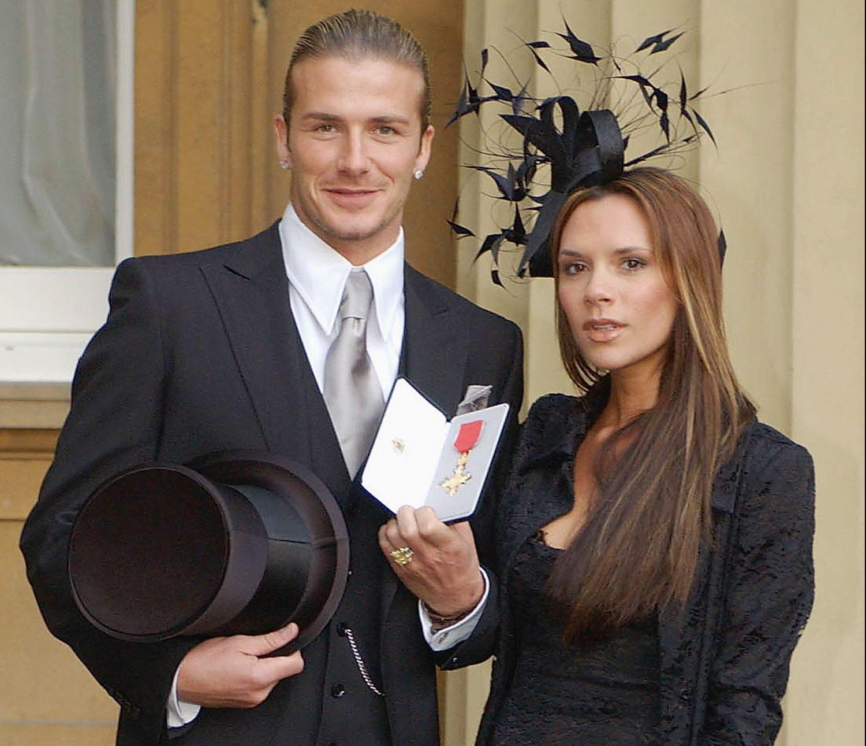 David Beckham supports wife Victoria Beckham at OBE ...
