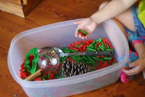 christmas sensory bin hands