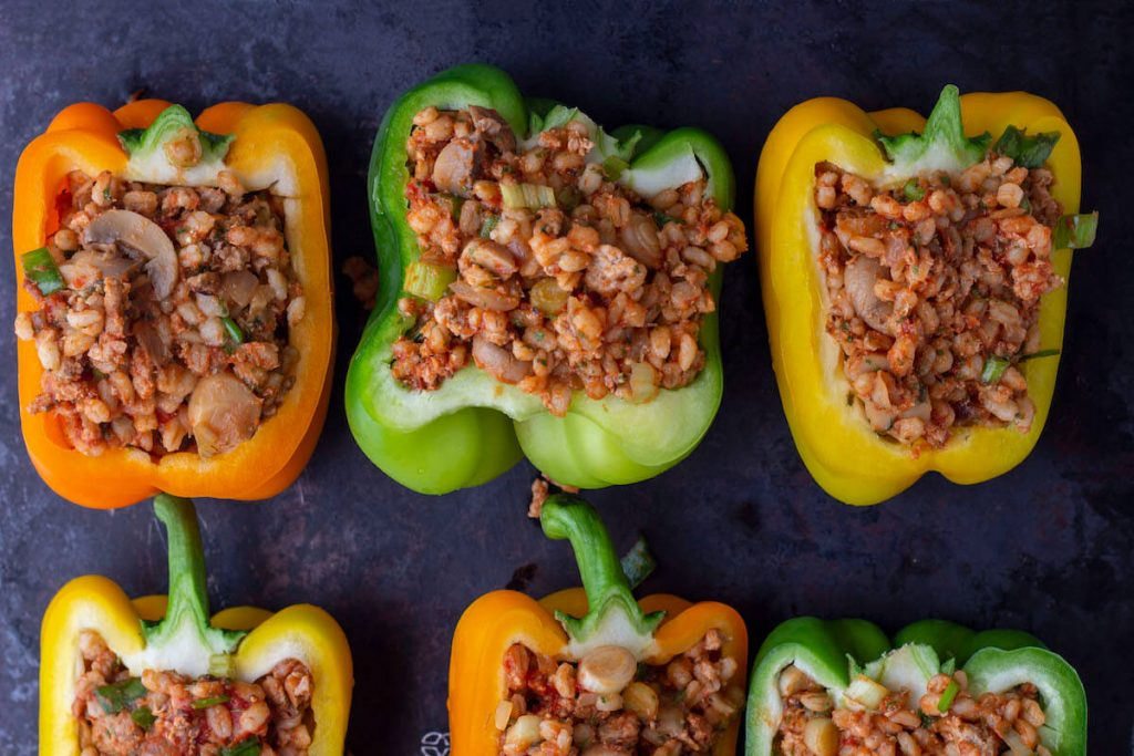 Healthy stuffed peppers with no rice, using barley and ground turkey as base of the filling.