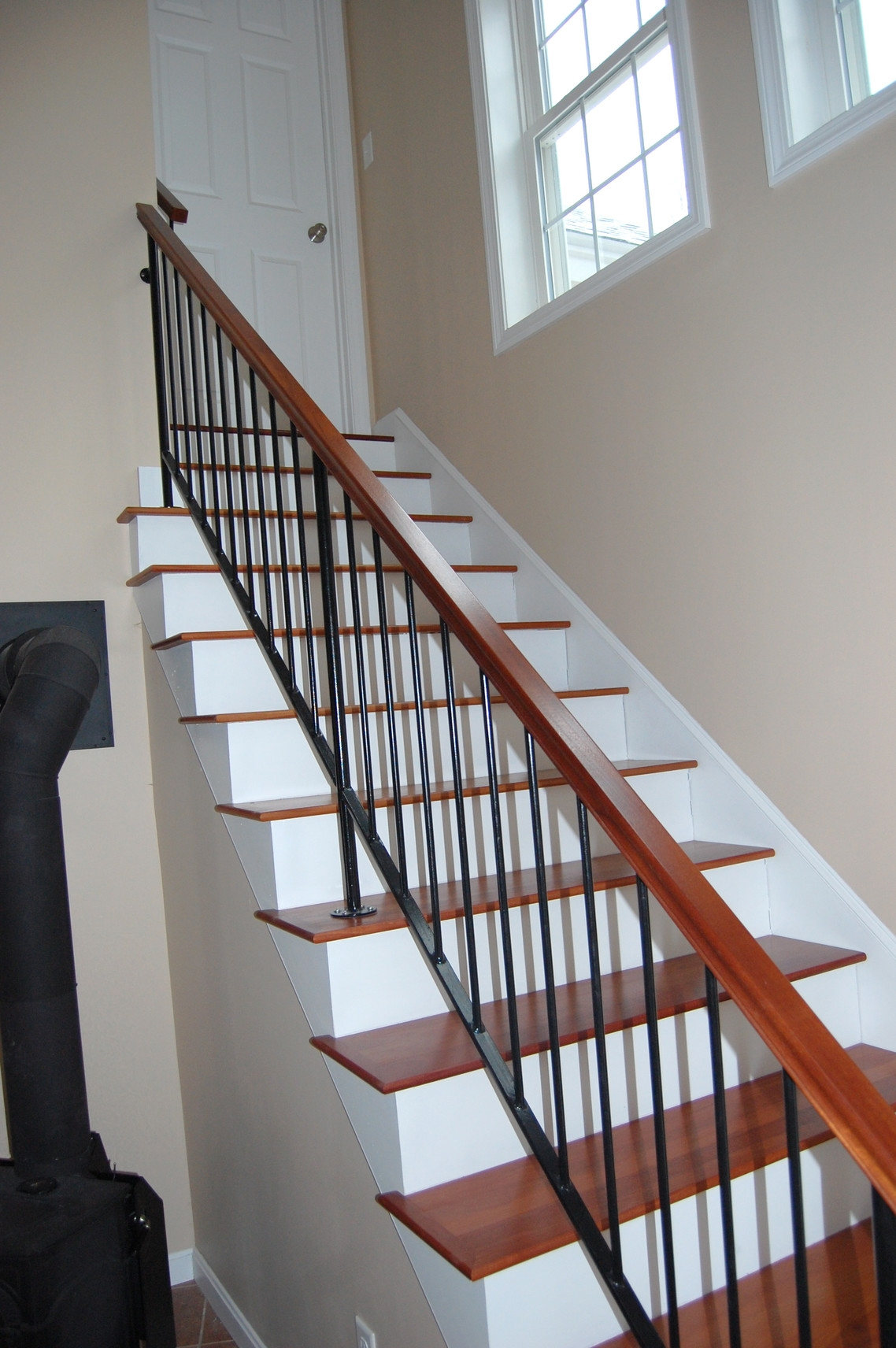 Custom Iron Railings Wrought Iron Railings Mill City Iron   Metal Railing With Wood Handrail   Cable Railing   Wrought Iron Balusters   Stainless Steel Railing   Deck Railing   Carpeted Stairs
