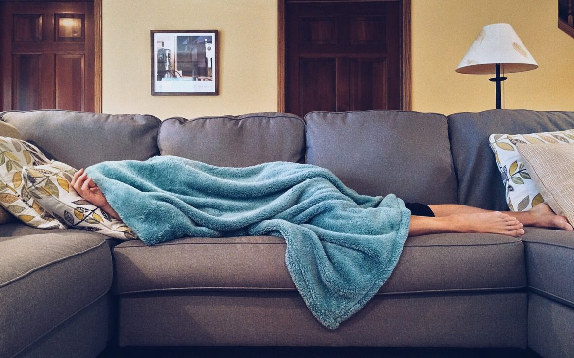 adult lying ill on the sofa HOW TO STAY CALM ABOUT CORONAVIRUS